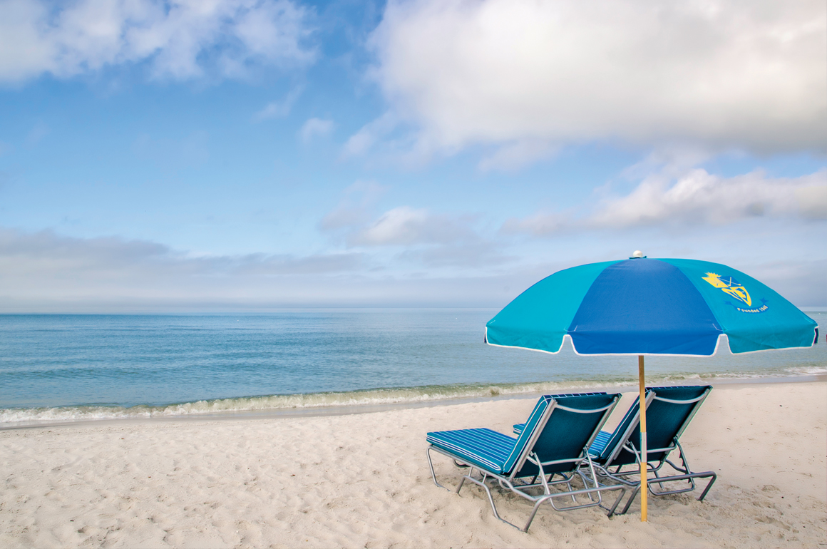 Beach Chairs with Umbrella - Looking out to the Gulf.jpg