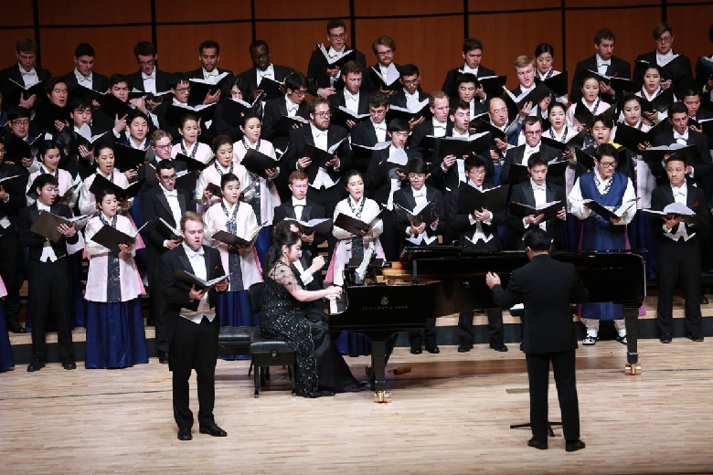 The two choirs combine to sing both American and Korean traditional songs