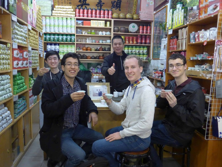 A group getting samples in a tea shop at the Shilin night market.