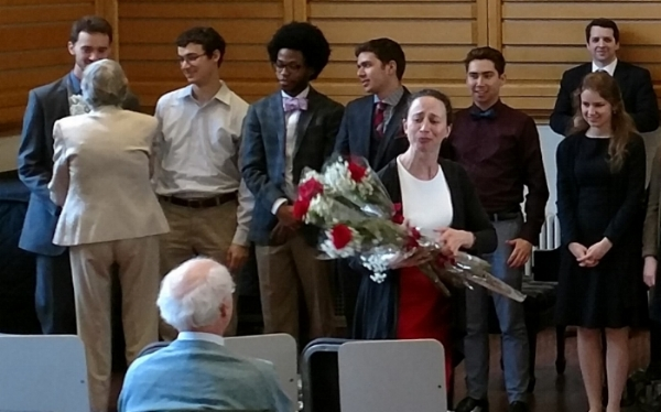 Elizabeth Eschen, Director of the Holden Voice Program, and Lisl Urban (who, along with husband, Warren Pyle '55, a Glee Club Alumnus and former Glee Club Foundation President, are the primary benefactors of the Holden Voice Program), present flowers to Glee Club members Westley Cook '20, Michael Horton '20, Nathan Robinson '20, Oliver Berliner '20, and Adrian Berliner GSAS at the Spring 2018 Student Recital.