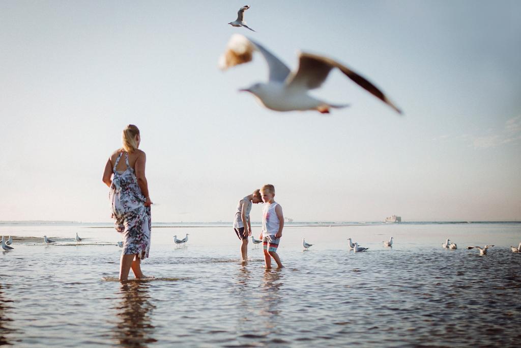 family photography at mornington peninsula - feeding the seagulls