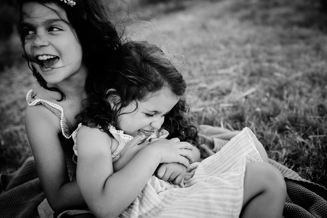 sister relationship - cuddles - family photography Melbourne