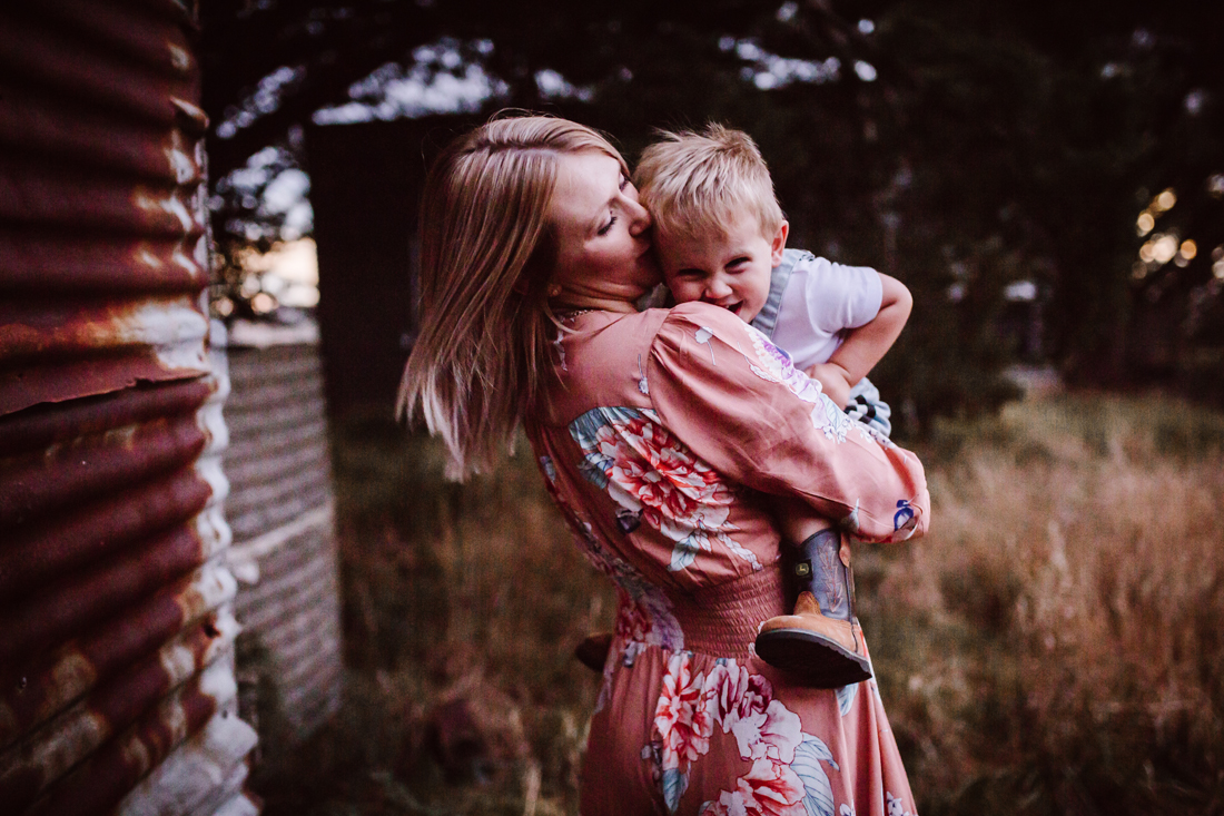 mother and son cuddles - blue hour - sunset - family photographer Berwick