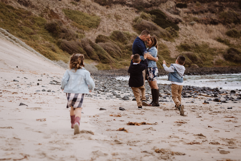 Melbourne family photographer - parent love - kids - beach fun