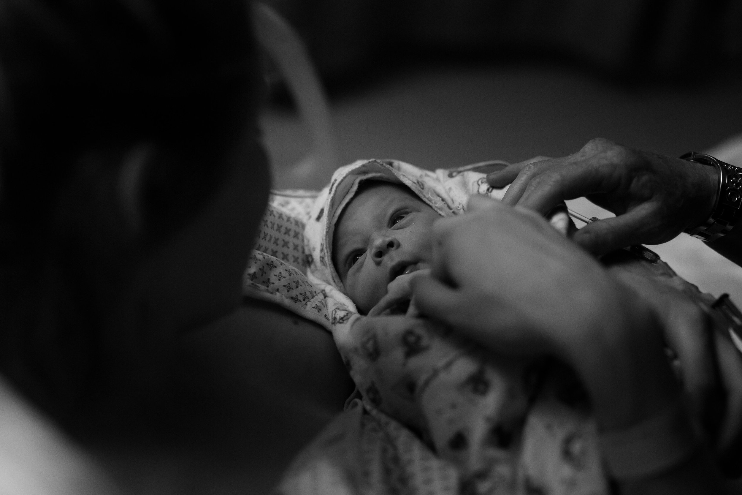 My sister meeting her baby boy - my very first birth photography experience.