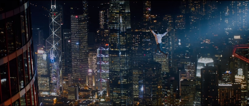 Strike the pose: Dwayne Johnson flies over Hong Kong.