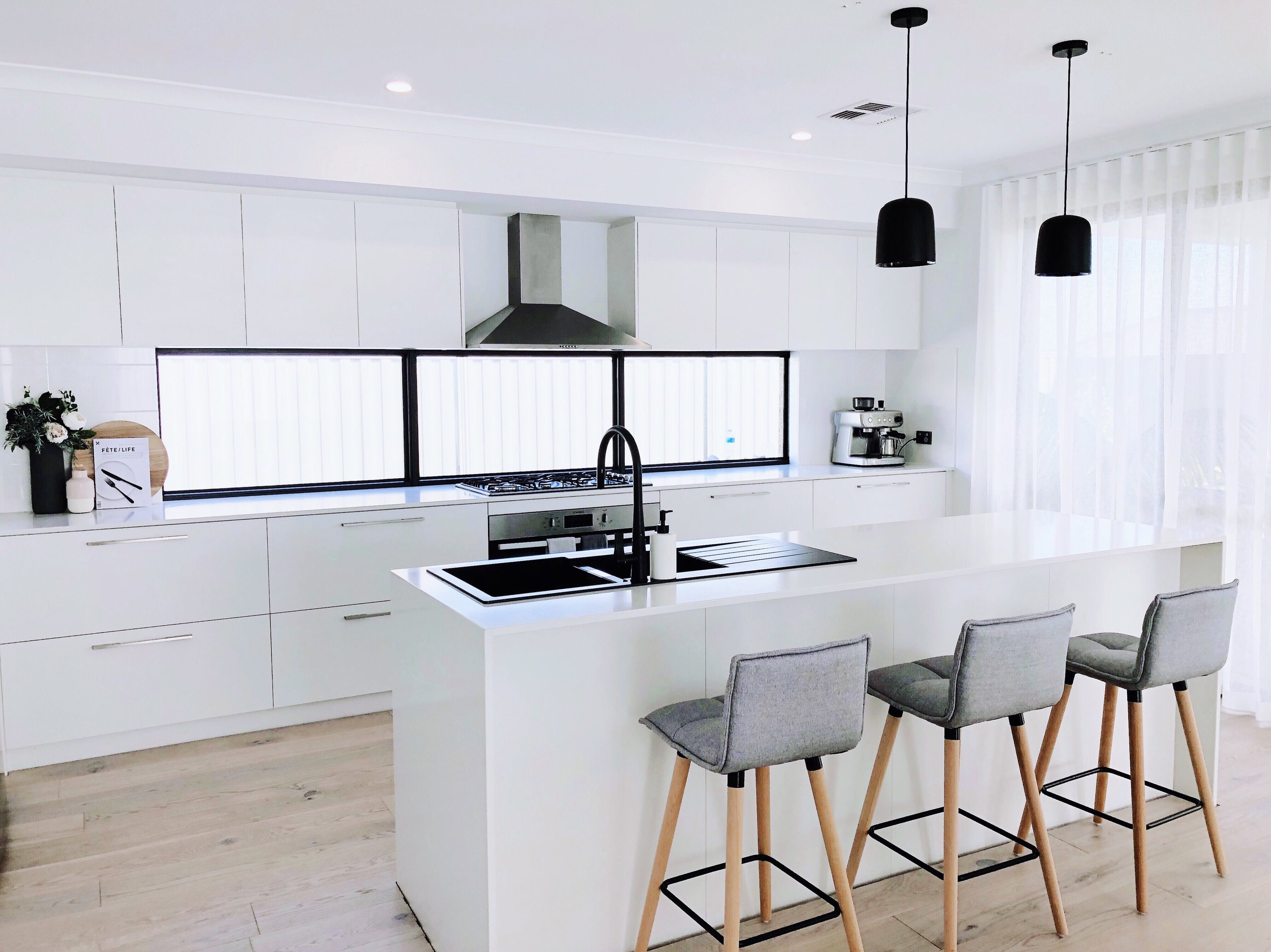 Here I have featured the beautiful Faraday Silver Counter Stools! I think these stools really soften this space and work perfectly in our white kitchen.  Shop the look below -