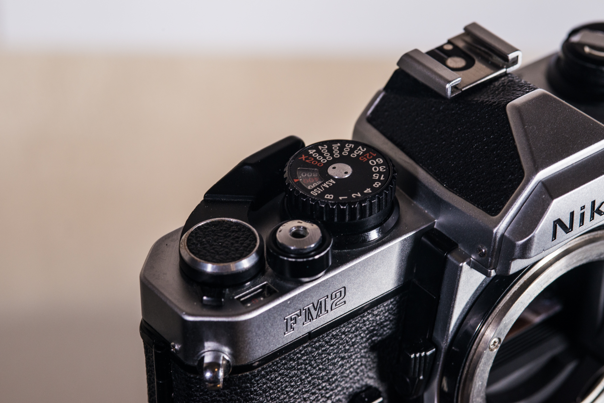 FM2's control area. Note the small tab just off of the advance lever, which stops the film from advancing. This also has a more modern style shutter button and faster flash X-sync speed of 1/200.