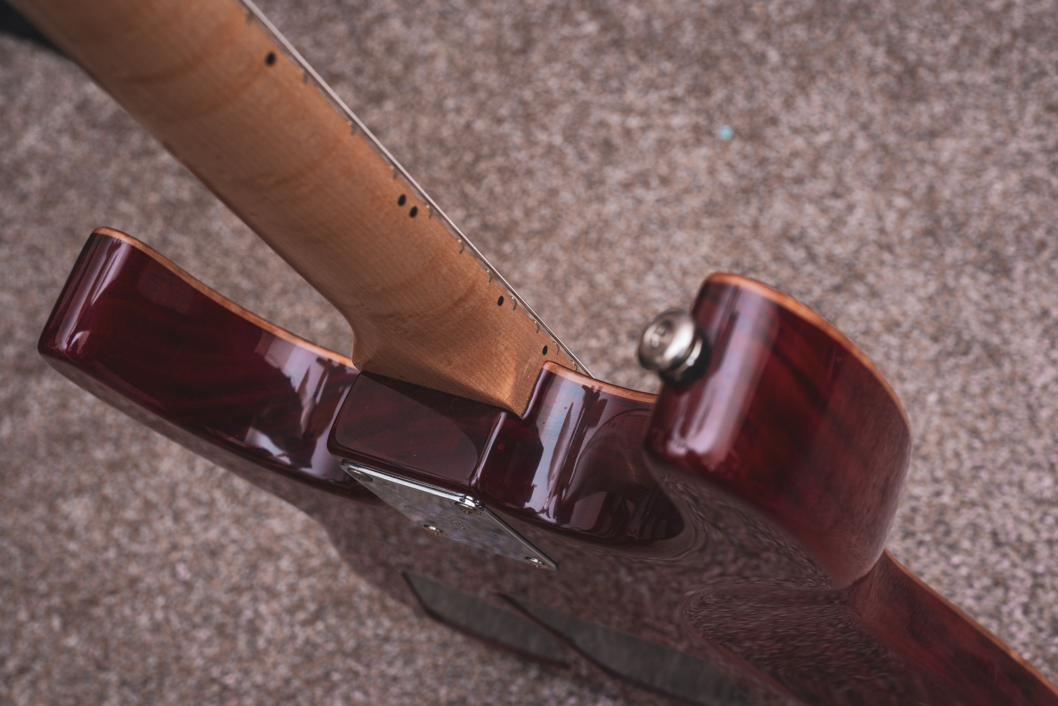 The mahogany body is beautifully figured in its own right, though not as flashy as the maple pieces.