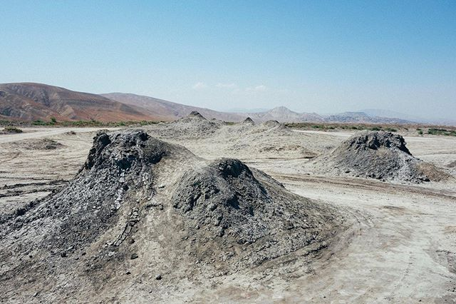 Here is a view from the top of one of the mud volcanoes looking out. There were probably 60 or more of these 10-15ft volcanoes on this plain. ⠀ ⠀  @scramblerducati @ducatiuk @movember @revit_official @revit_adventure⠀ ⠀