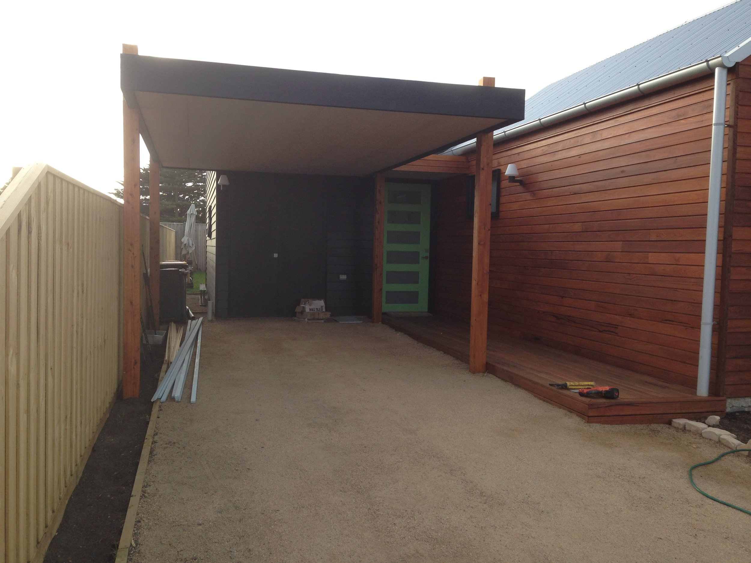 Flat roof carport.