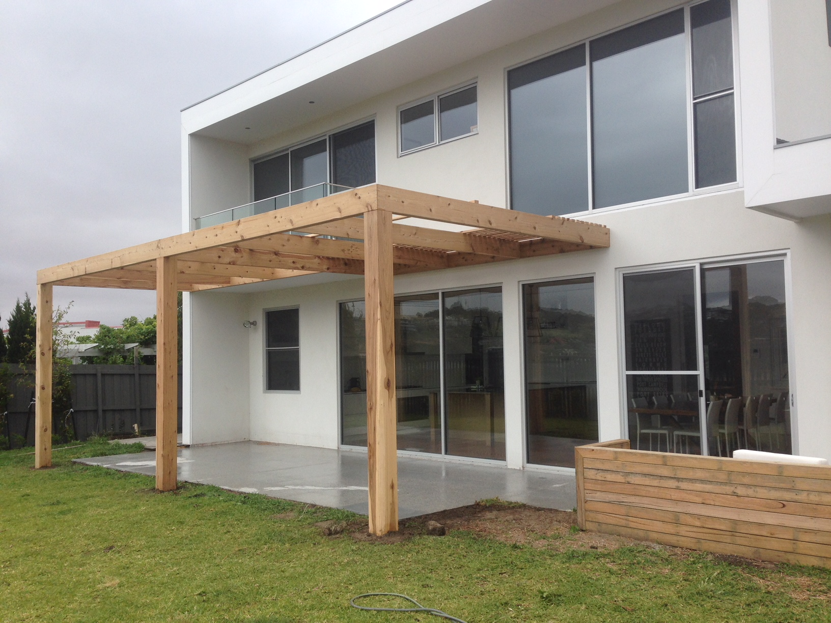 Cypress open pergola with shade battens.