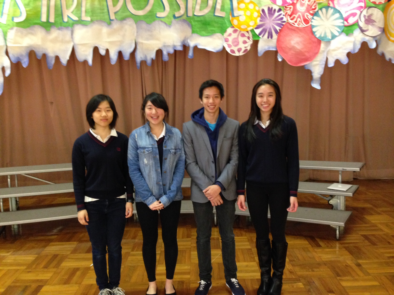 Joseph (second right) and senior leaders promoting our first program at Tak Oi Secondary School (2014)