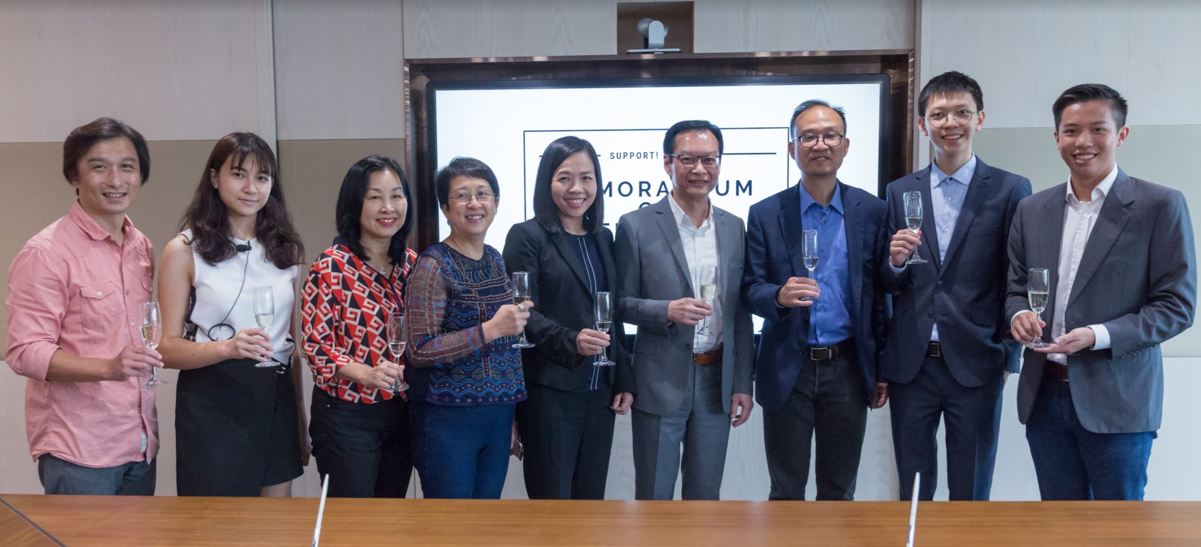 Representatives from the Foundation and BGCA toasting to the partnership's success!    (L-R: Mr Wing Kin Chan, Supervisor, Sha Tin District, BGCA; Ms Francisca Lam, Foundation's Vice President, Operations (Primary Programmes); Ms Dilys Lai, BGCA Assistant Director; Ms Peonie Wong, Foundation's Executive Director; Ms Jacqueline Lam, Foundation's Board Director; Ir Wai Chi-Sing, GBS JP, Foundation's Board Director and Signing Representative; Mr Charles Chan, BGCA Executive Director; Mr Alex Yu, Foundation's President (Designate); Mr Joseph Wan, Foundation's President)