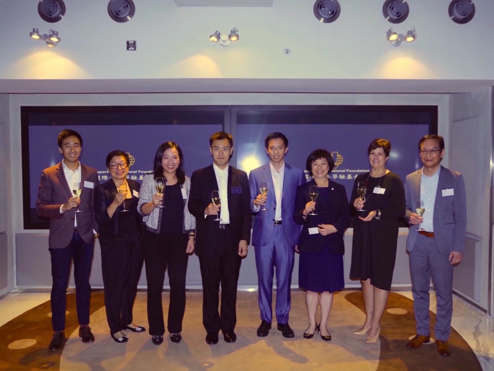 Board of Directors Toast (L-R: Gary Liu, Anna Lo, Jacqueline Lam, Chairman Ming Wai Lau, Founder & President Joseph Wan, Bonnie Ngan, Abigail DeLessio, C S Wai)