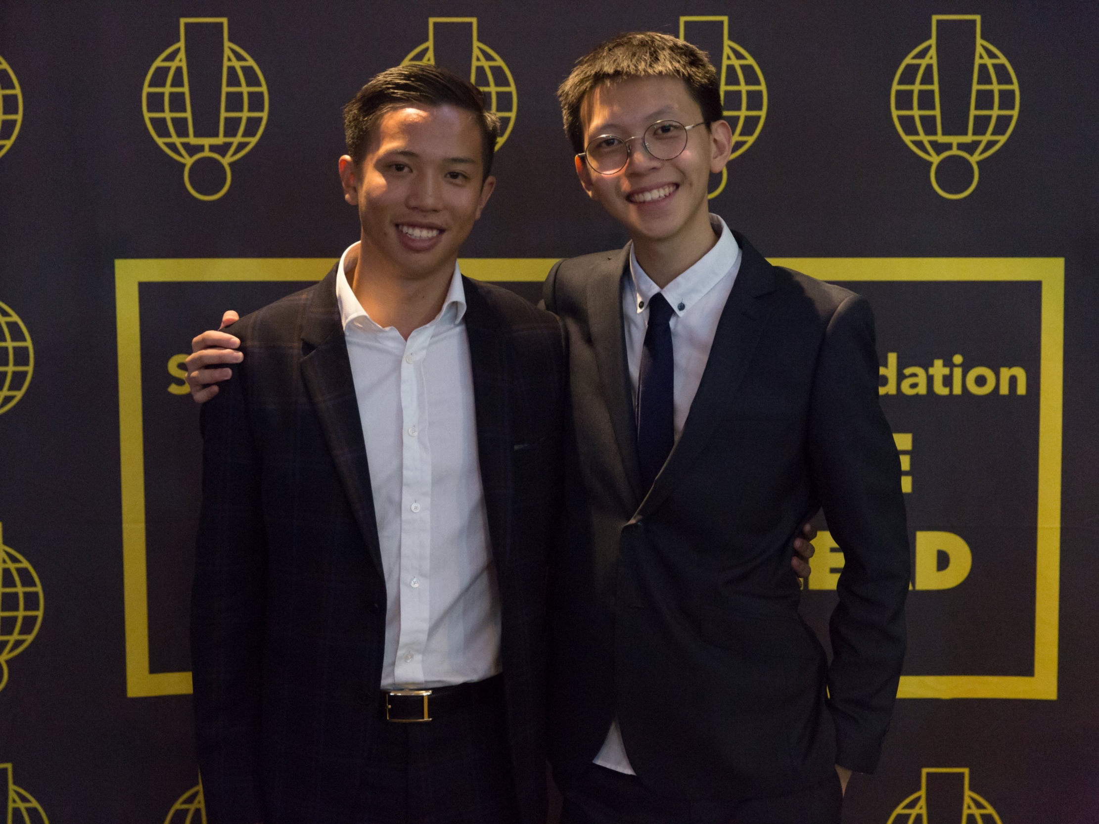 Founder and President Joseph Wan with his successor, Alex Yu