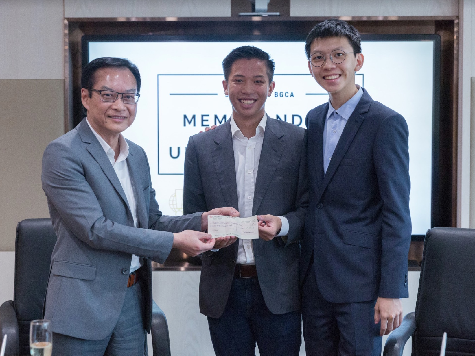 Ir Wai presenting a donation cheque to the Foundation as a token of appreciation to President Joseph Wan's service over the past four years, and this being his last official event