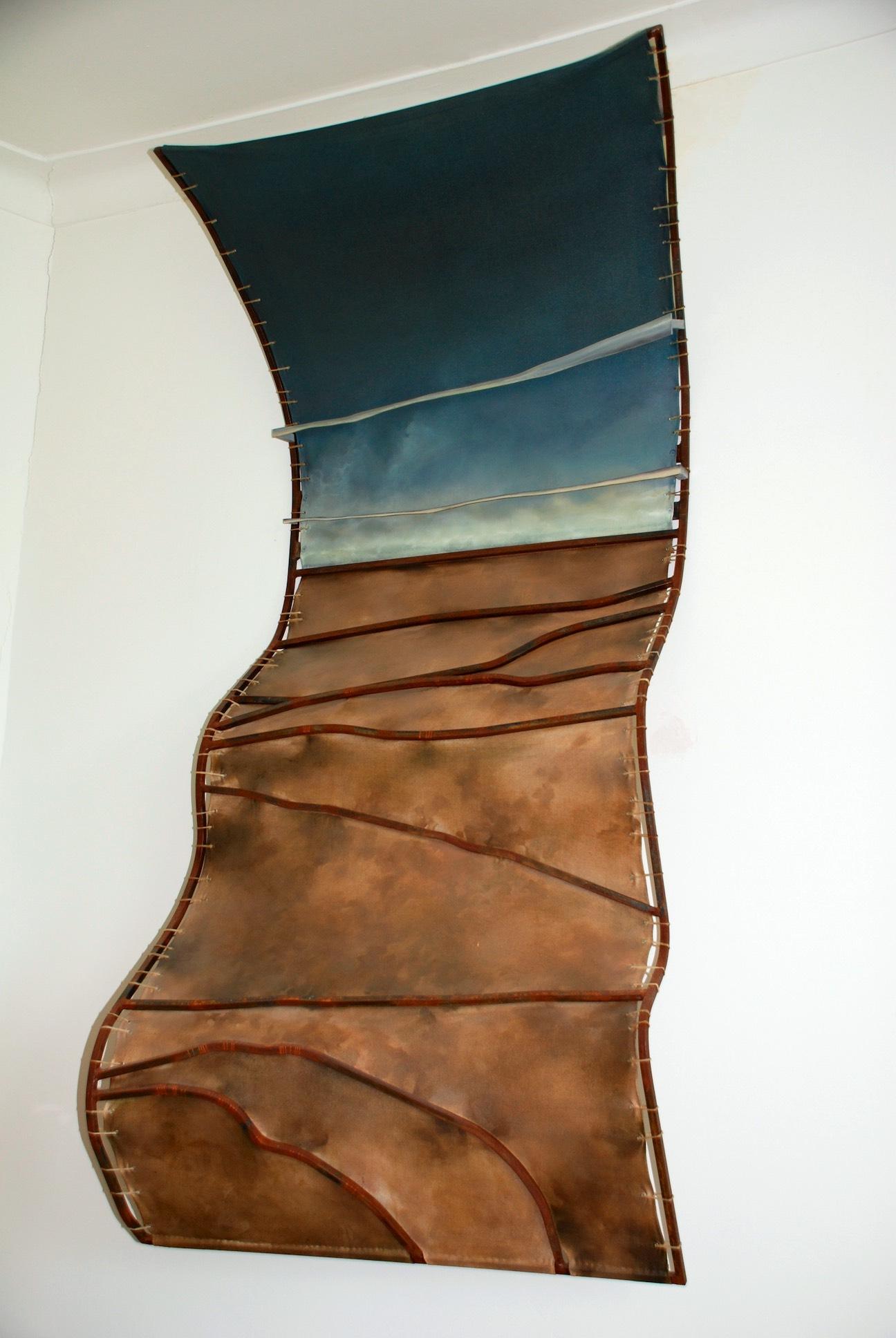 Rock desertscape with metal frame