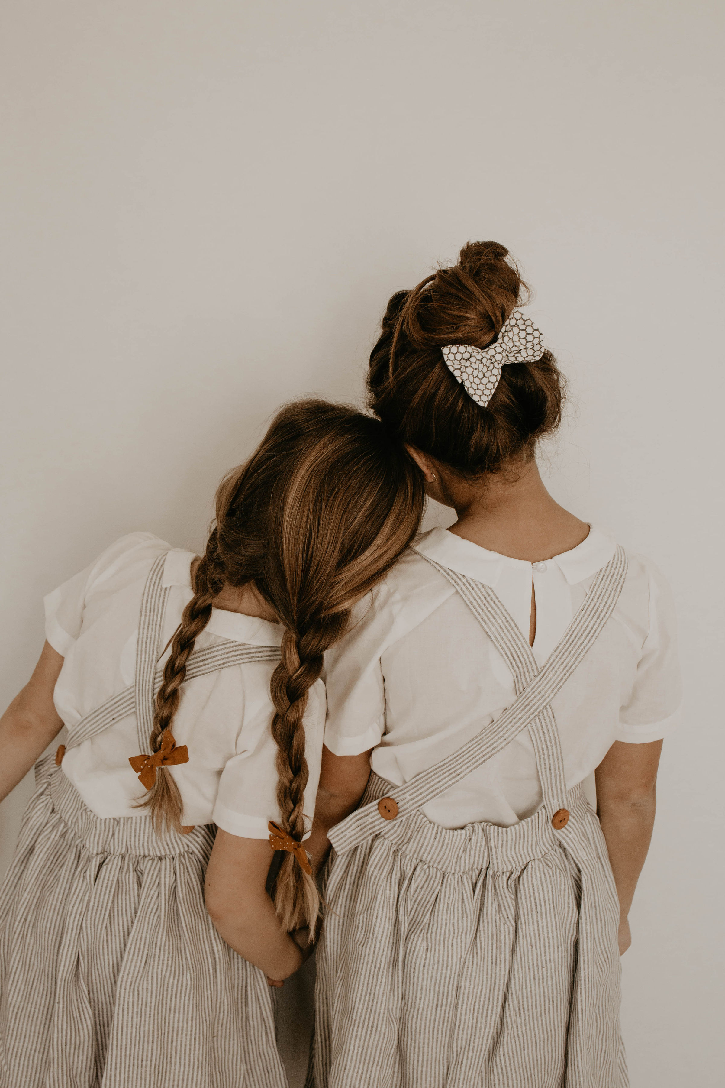 Bows - Our bow have been carefully crafted for your little girl. Guaranteed to not untie or come undone! Bows come on your choice of nylon headband, alligator clip, or barrettes. Our nylon headbands are slightly larger and stretchier than most popular brands. This allows the baby to comfortably wear our headbands without leaving any red marks or dents in the baby's head.