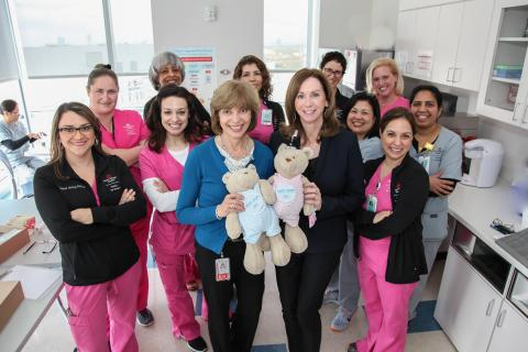 Dr. Nancy Hurst (center, in blue) with her colleagues at Texas Children's Hospital