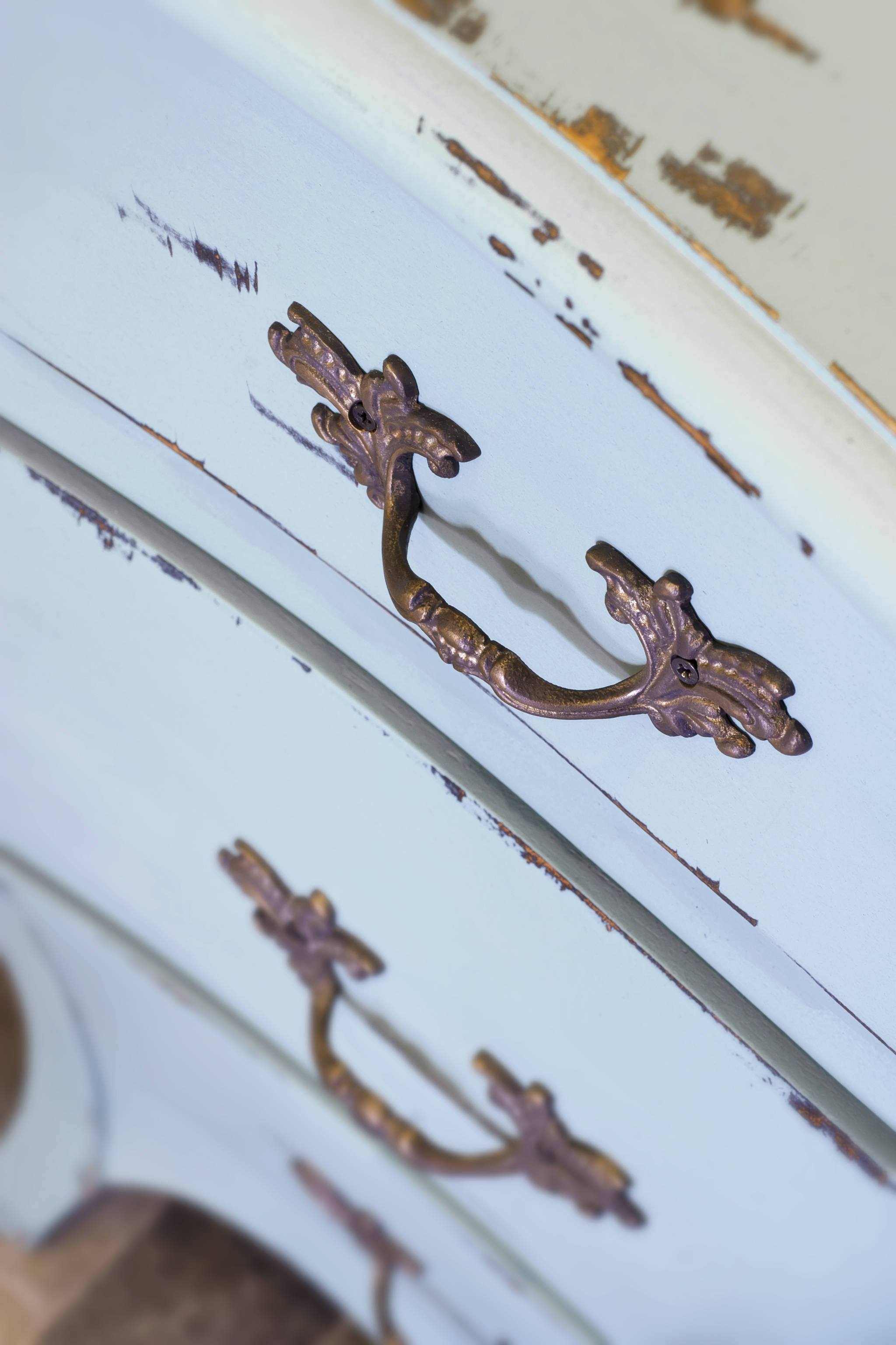 Vintage style, blue painted drawers with ornate metal handles.