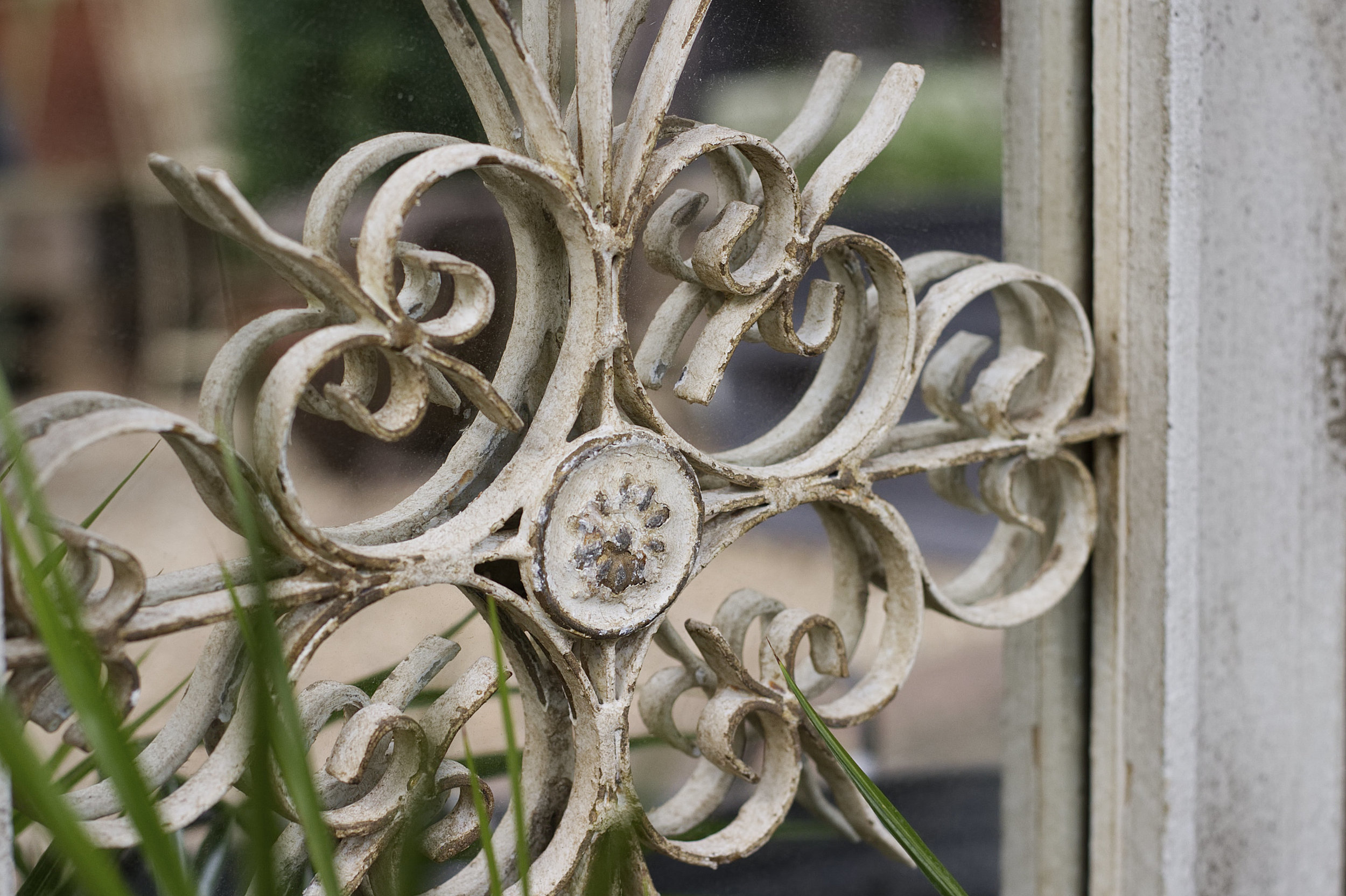 close-up view of metal railing with intricate swirling design