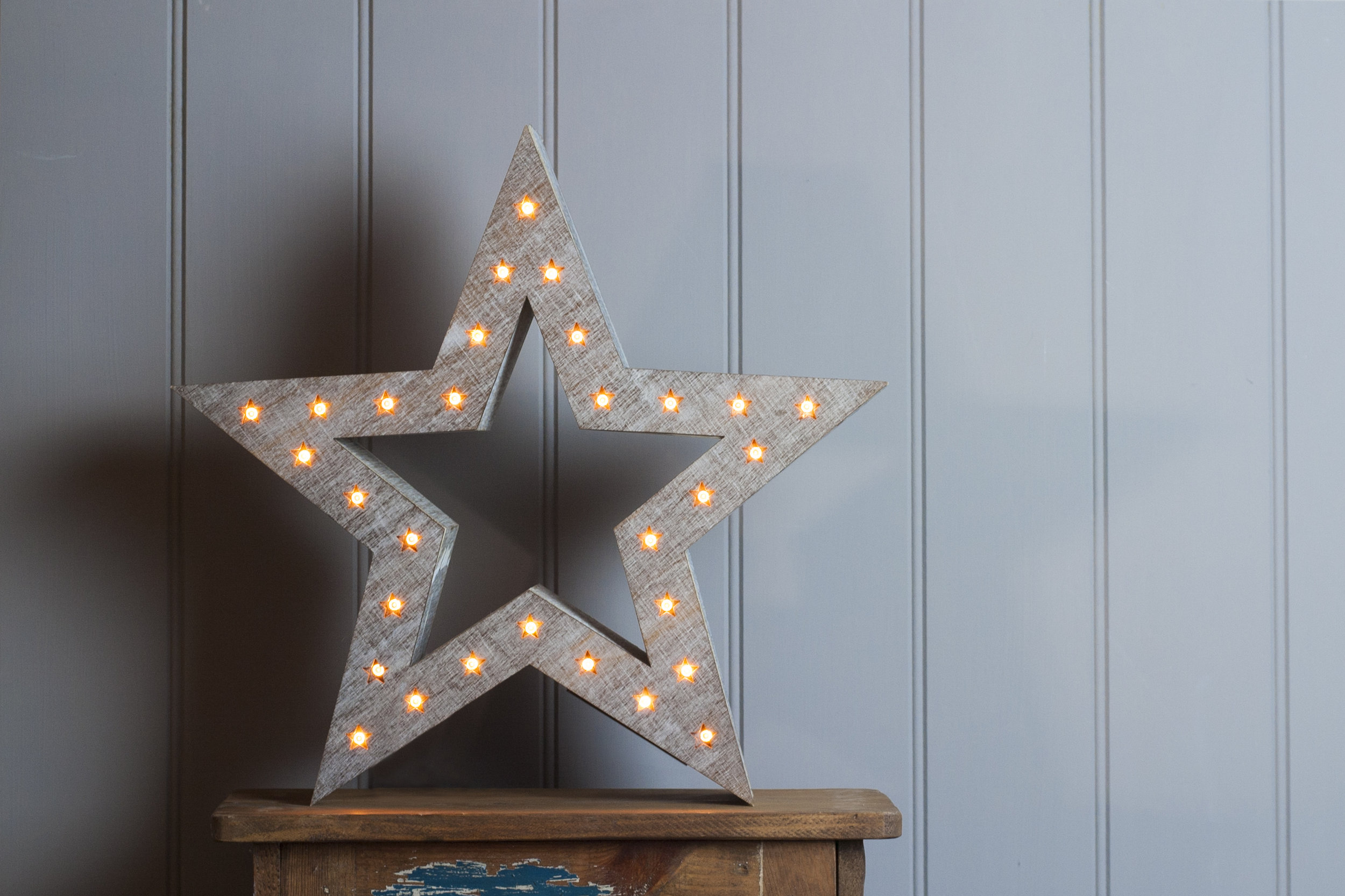 wooden Christmas star with lights embedded