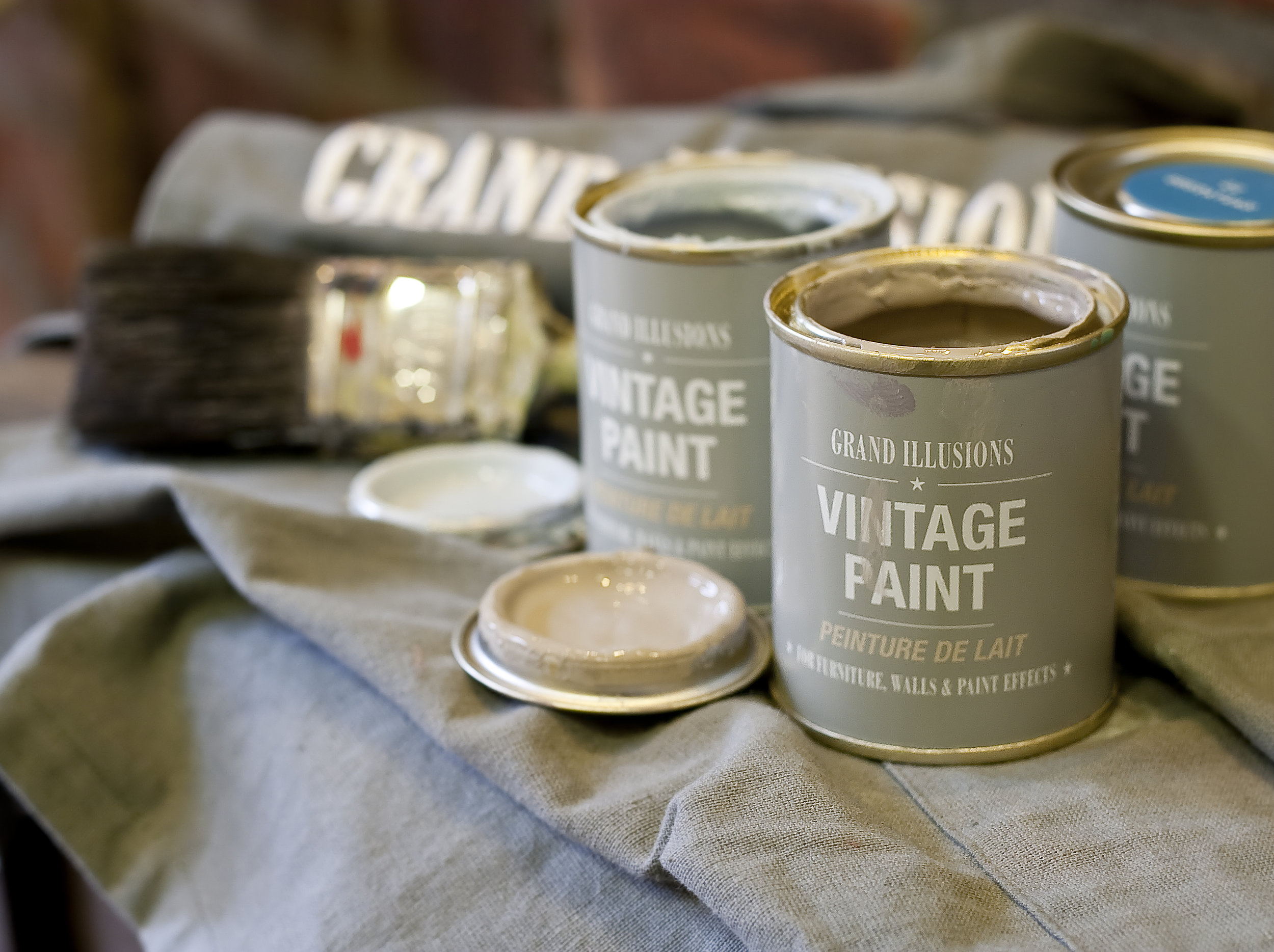Three Vintage paint pots with lids removed