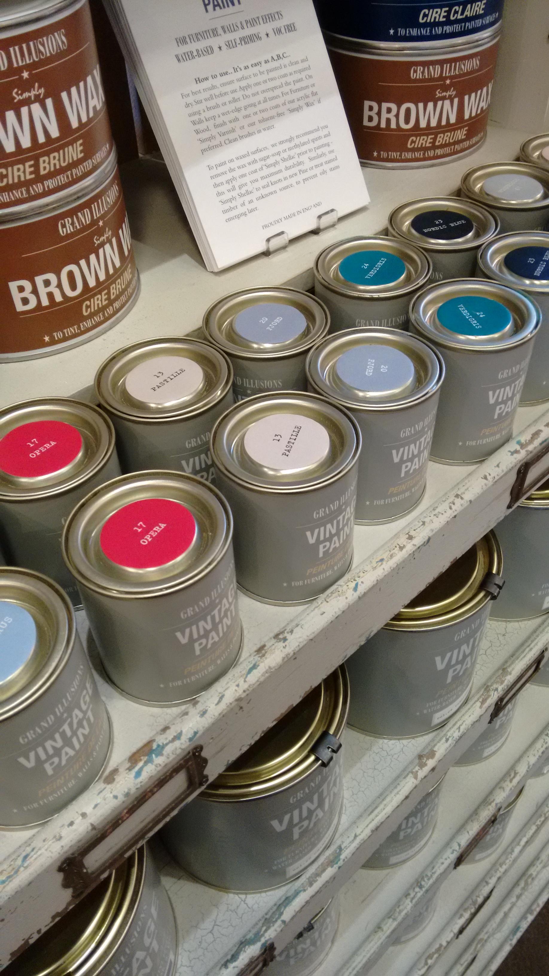 Vintage paints arranged on shop shelves