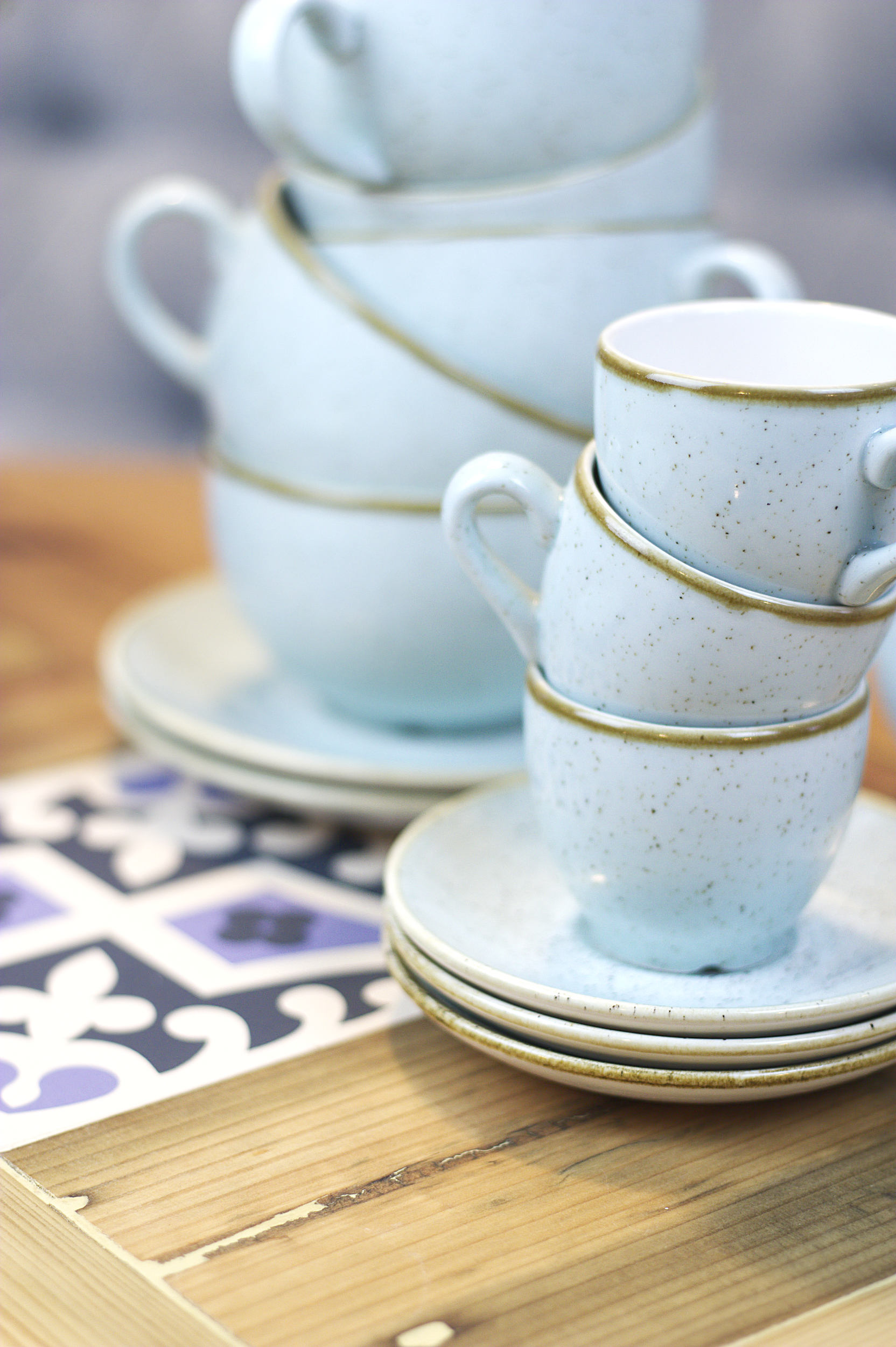 A pretty stack of duck-egg blue cups and saucers.
