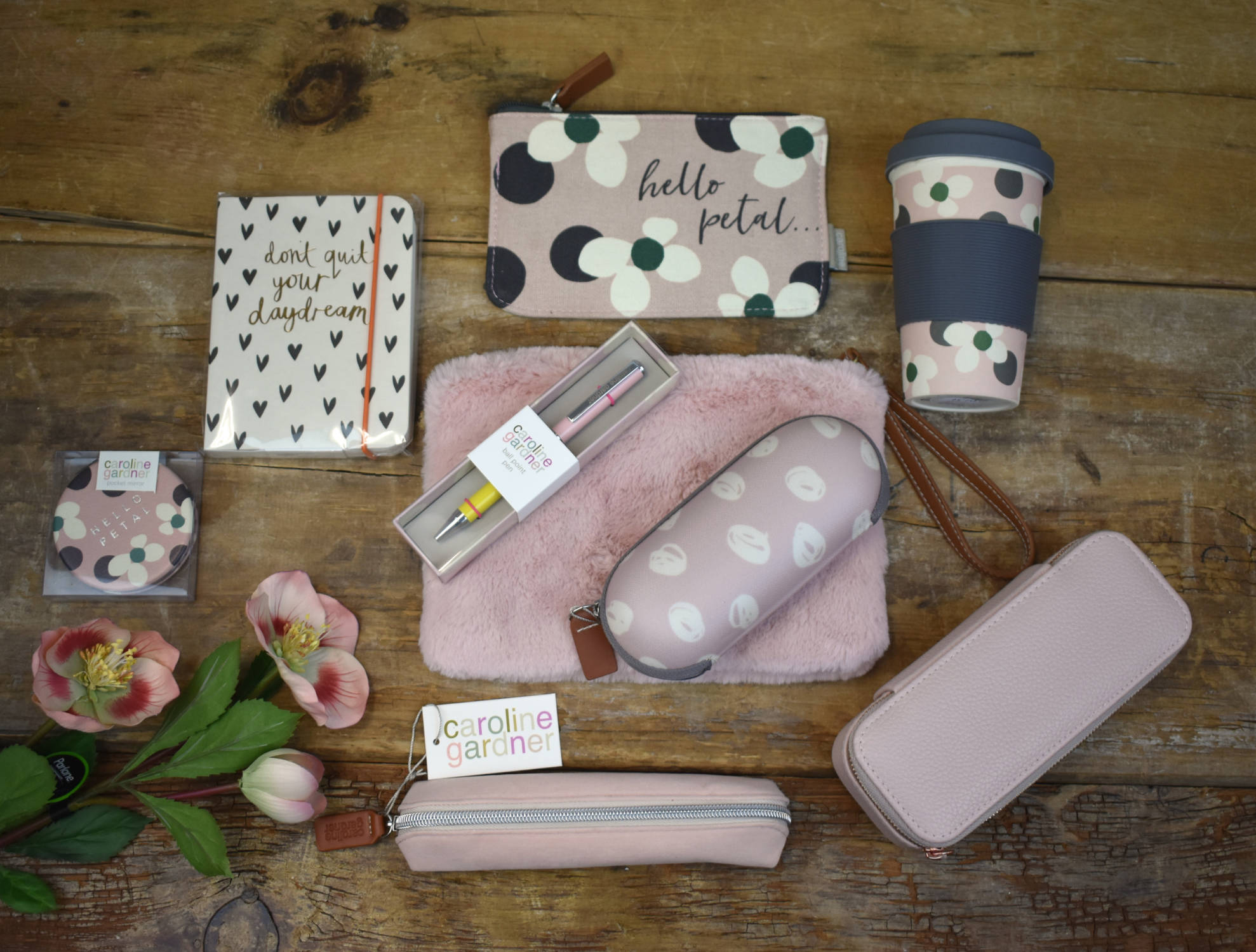 Pink Caroline Gardner accessories including 'don't quit your daydream' note book, 'hello petal' floral spot glasses pouch, pencil case and travel jewellery box.