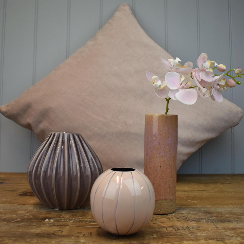 Textured vases and velvet cushion in soft blush pinks