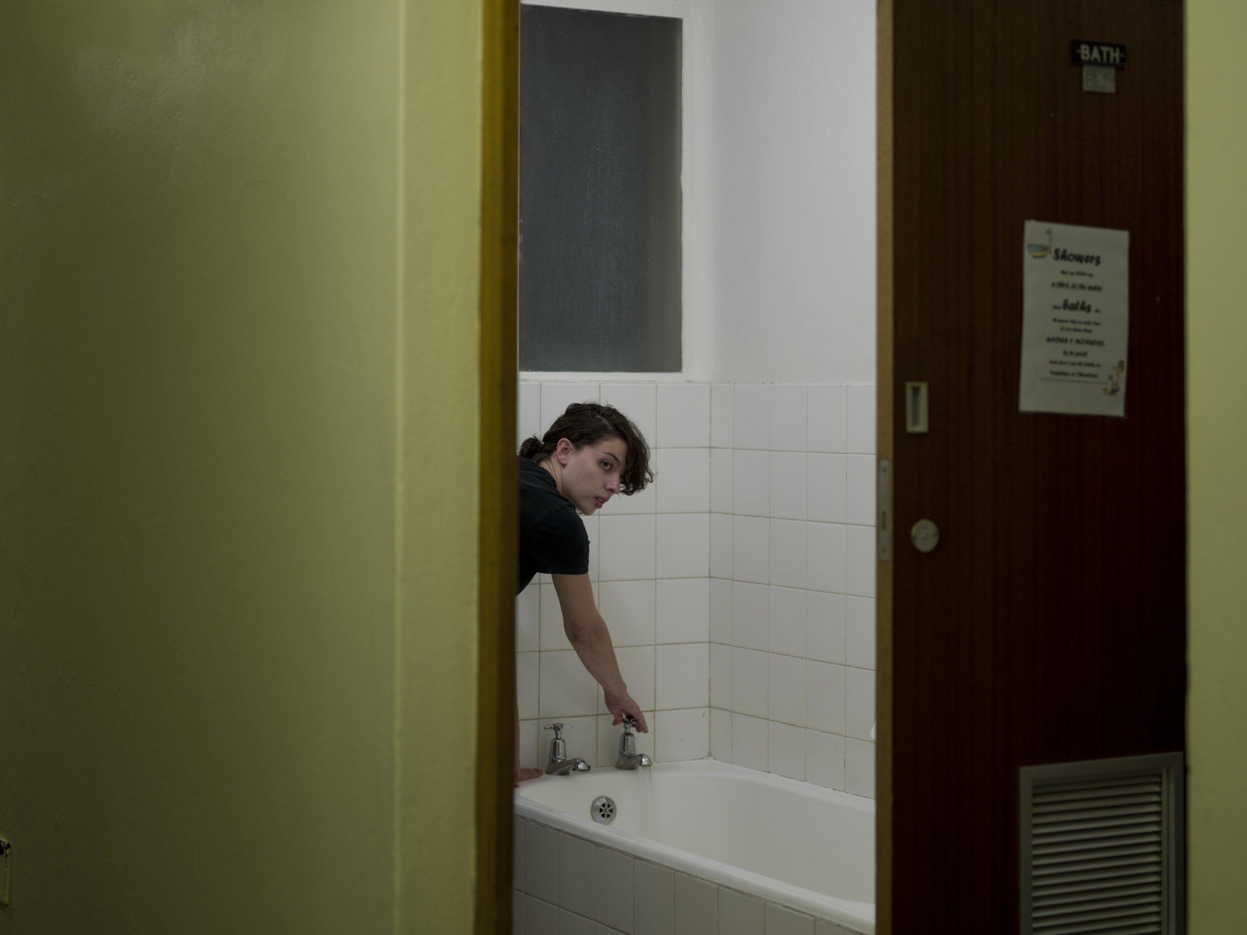 Alex running a bath, 2014