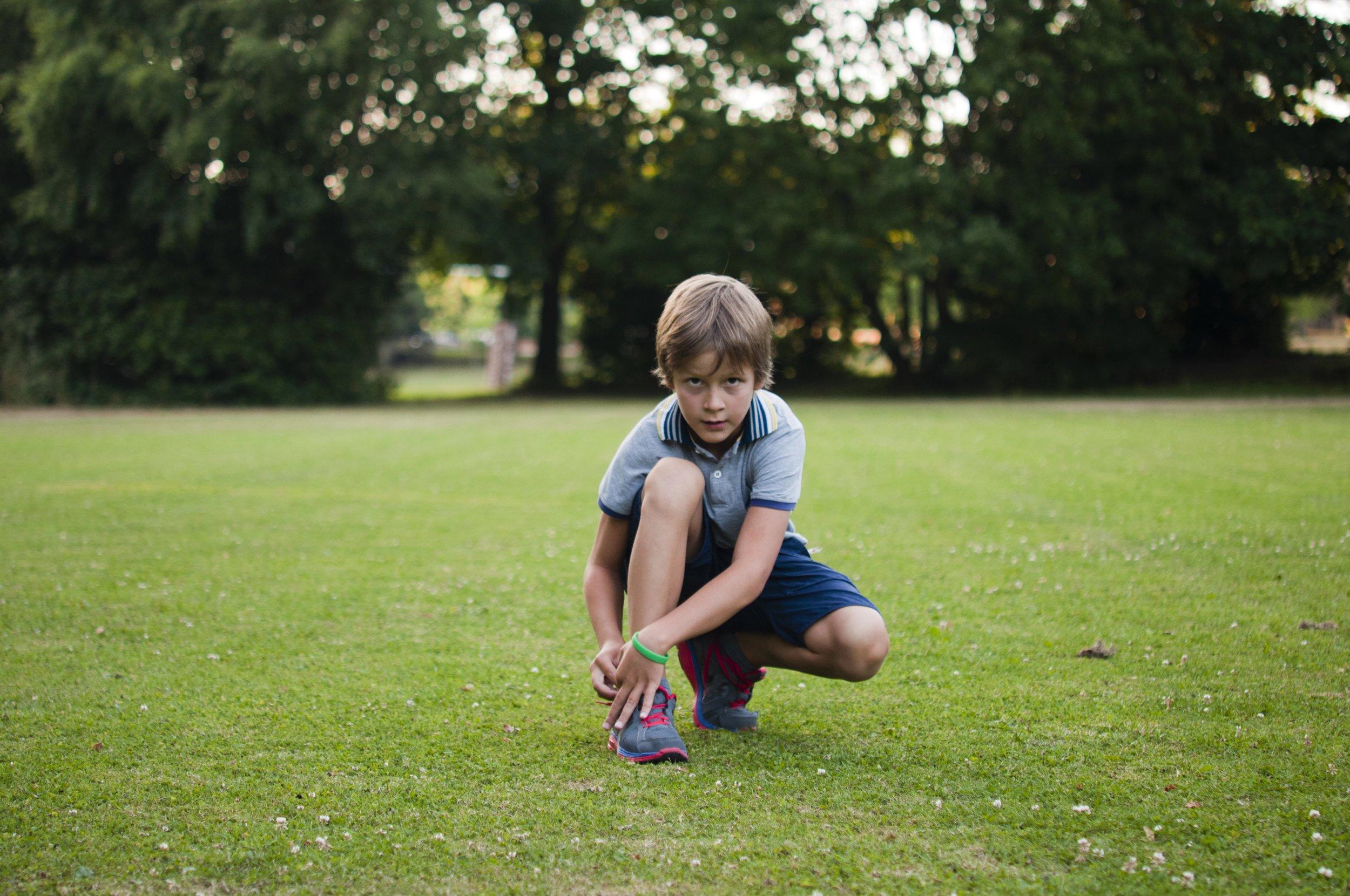 Johann tying his shoelaces, 2013