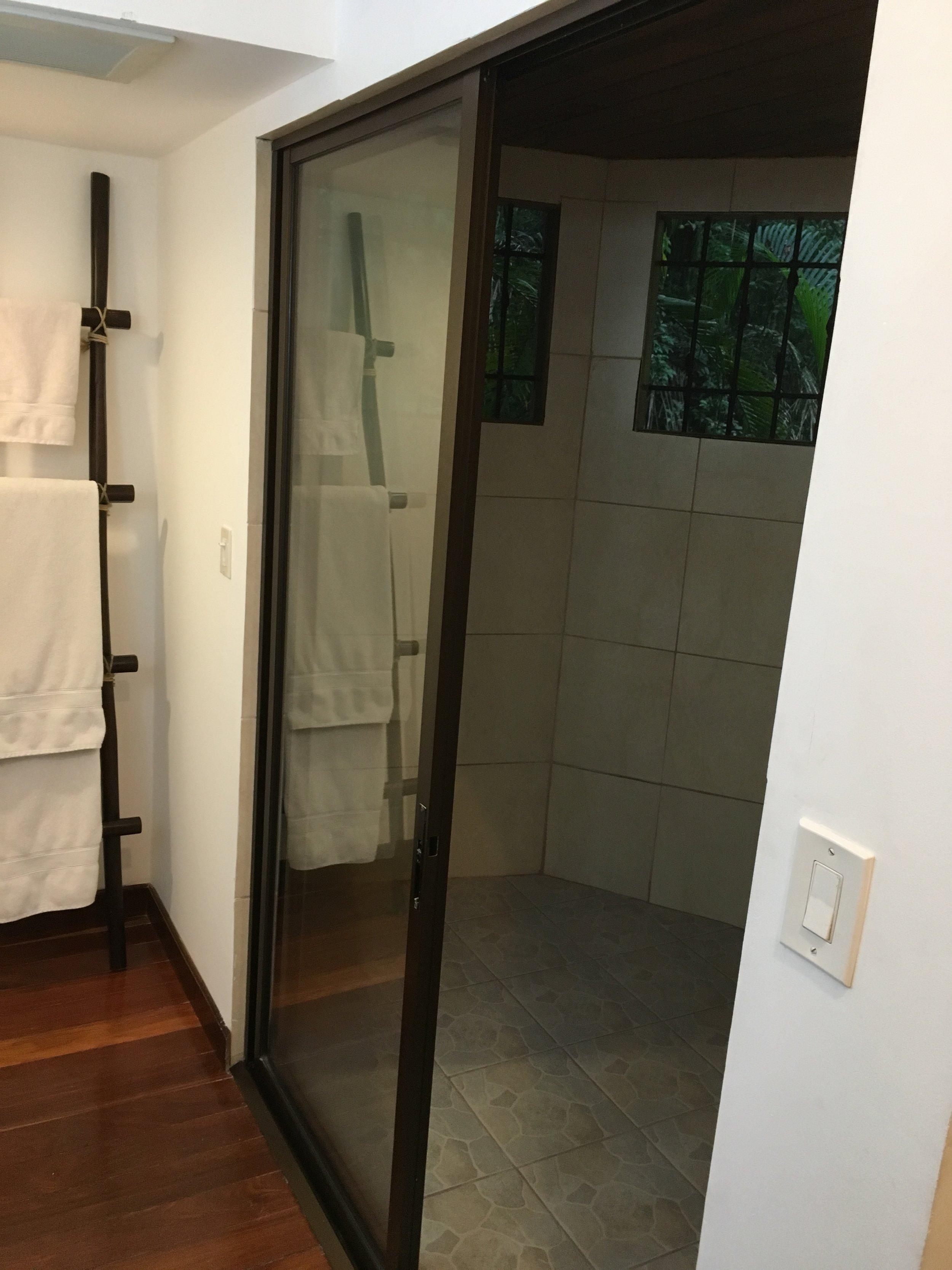 Indoor/outdoor shower in master bedroom