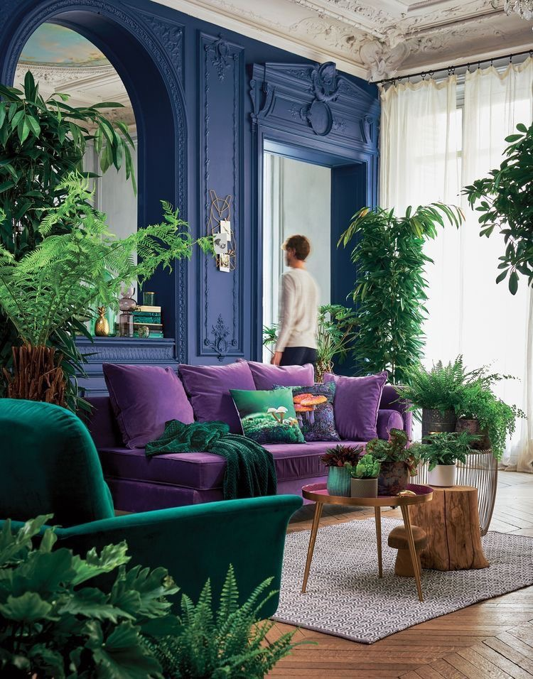 Vibrant solids - the blue and purple balance out the tremendous amount of greenery in this space.   Courtesy of Pinterest