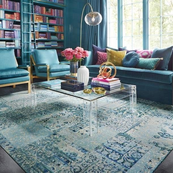 The significant presence of teal is broken up with the addition of brightly colored books and accent pillows.   Courtesy of Pinterest