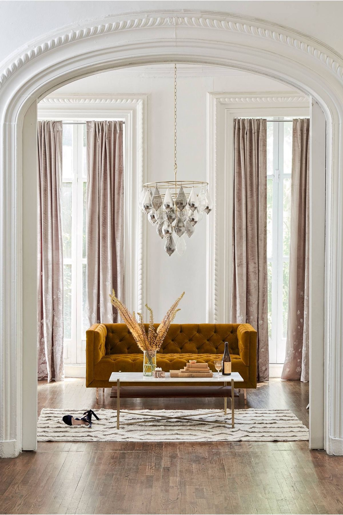 Velvet, marble, glass, brass, textured florals, a woven rug. Even minimalist designs require variety to become interesting.    Courtesy of Pinterest