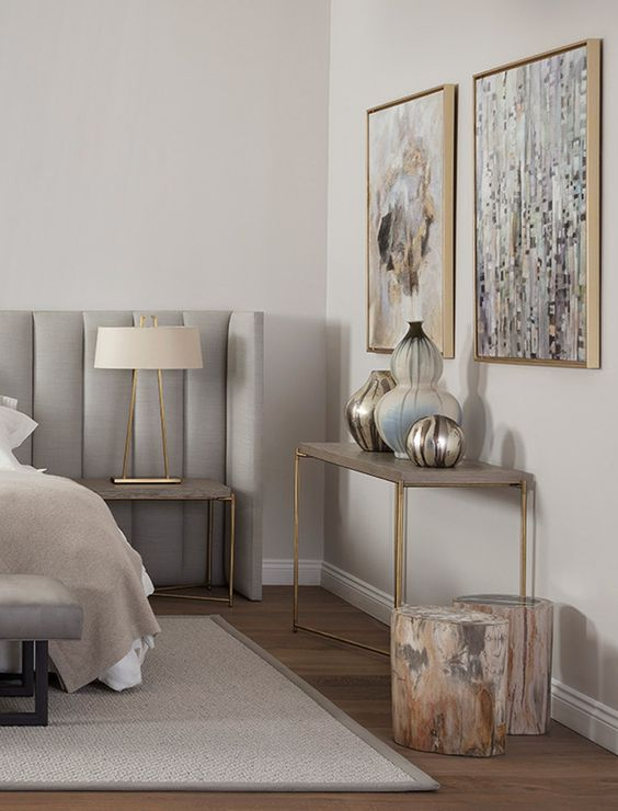 Here the blend of grey and gold is fairly evenly present, brought together by the beige bedding, light grey rug, abstract art, decor and stumps featuring a blend of warm & cool colors.   (Courtesy of Pinterest)