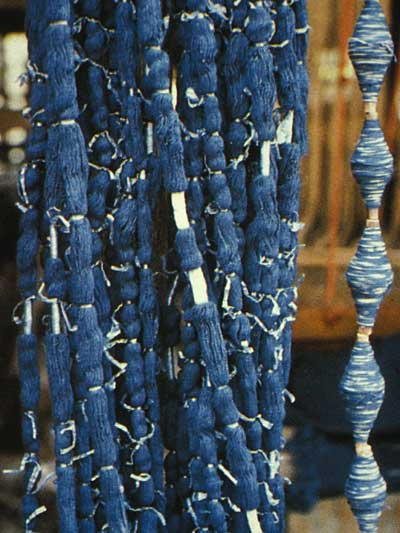 Ikat Resists, Untied Threads and Threads Wound onto Bobbins