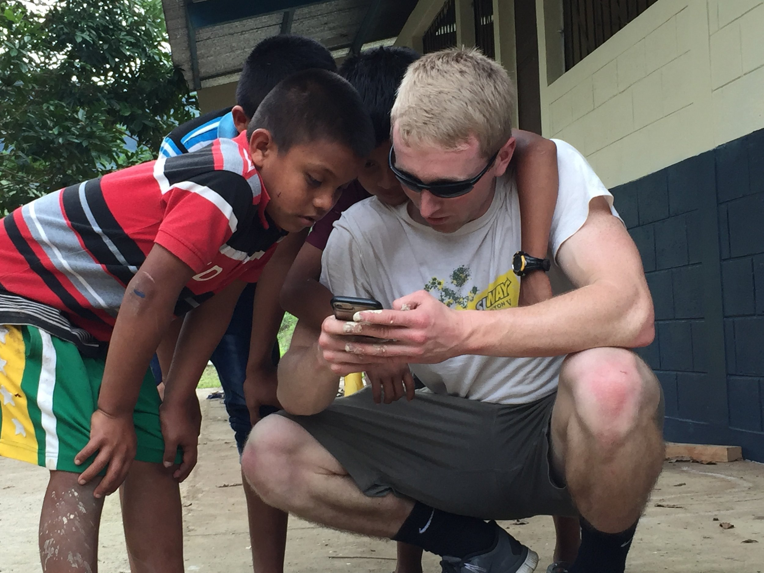 Boys with volunteer.jpg