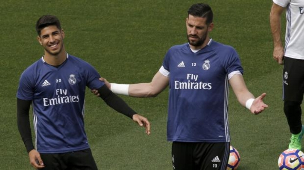 Marco Asensio (left) with Kiko Casilla at Real Madrid. Asensio participated at the Cerdanya Cup with Balearic Islands Regional Team as a youth.