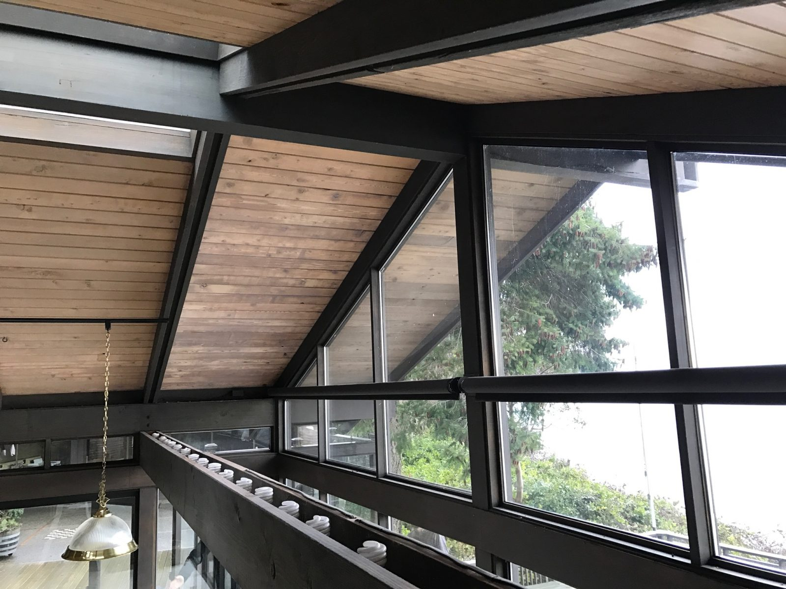 PHOTO OF SOUTH HOUSE CEILING. TONGUE AND GROOVE WOOD IS CONTINUOUS FROM INTERIOR TO EXTERIOR.