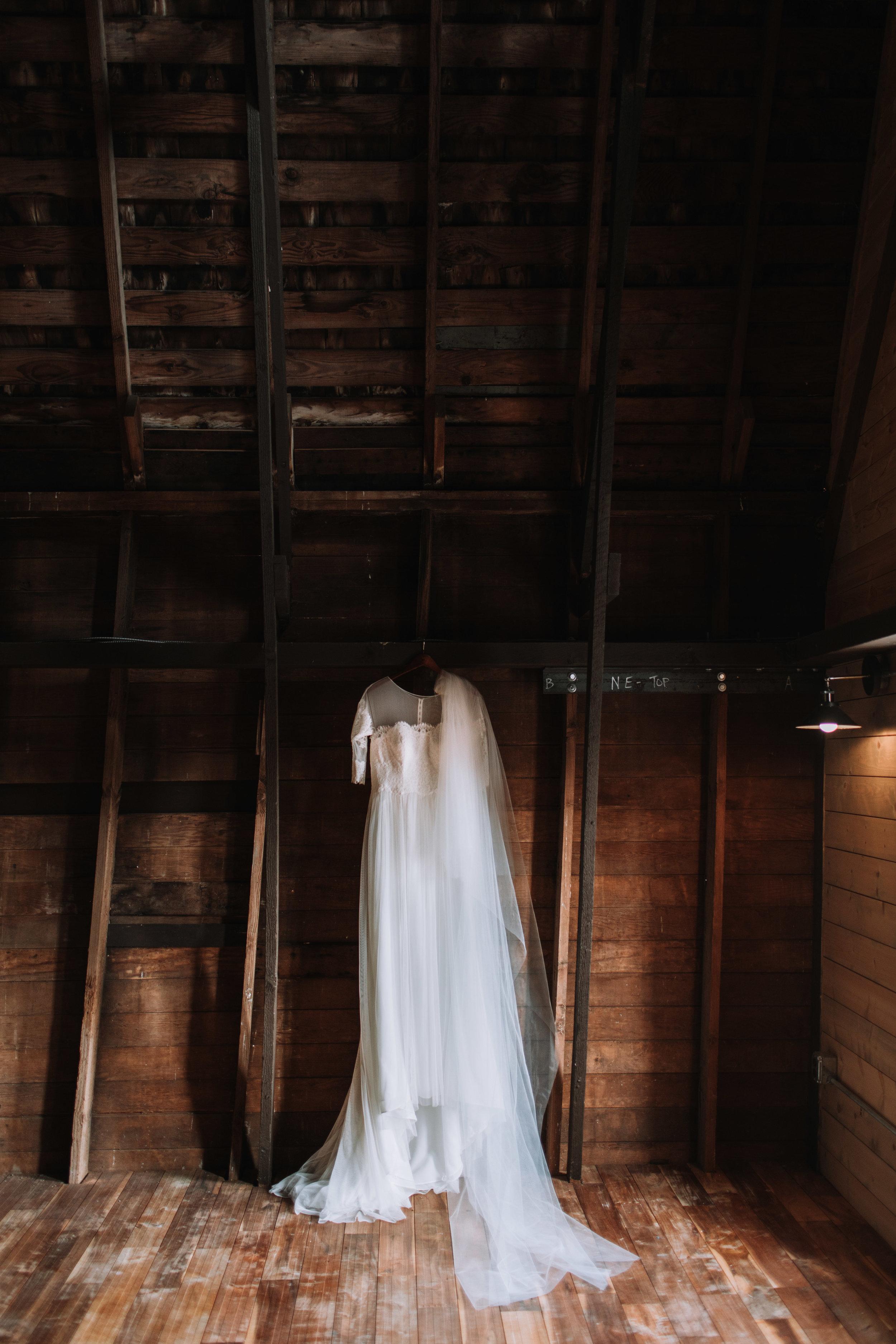 adam sophie red barn wedding arlington washington foggy day pnw wedding gown photo cedar wall
