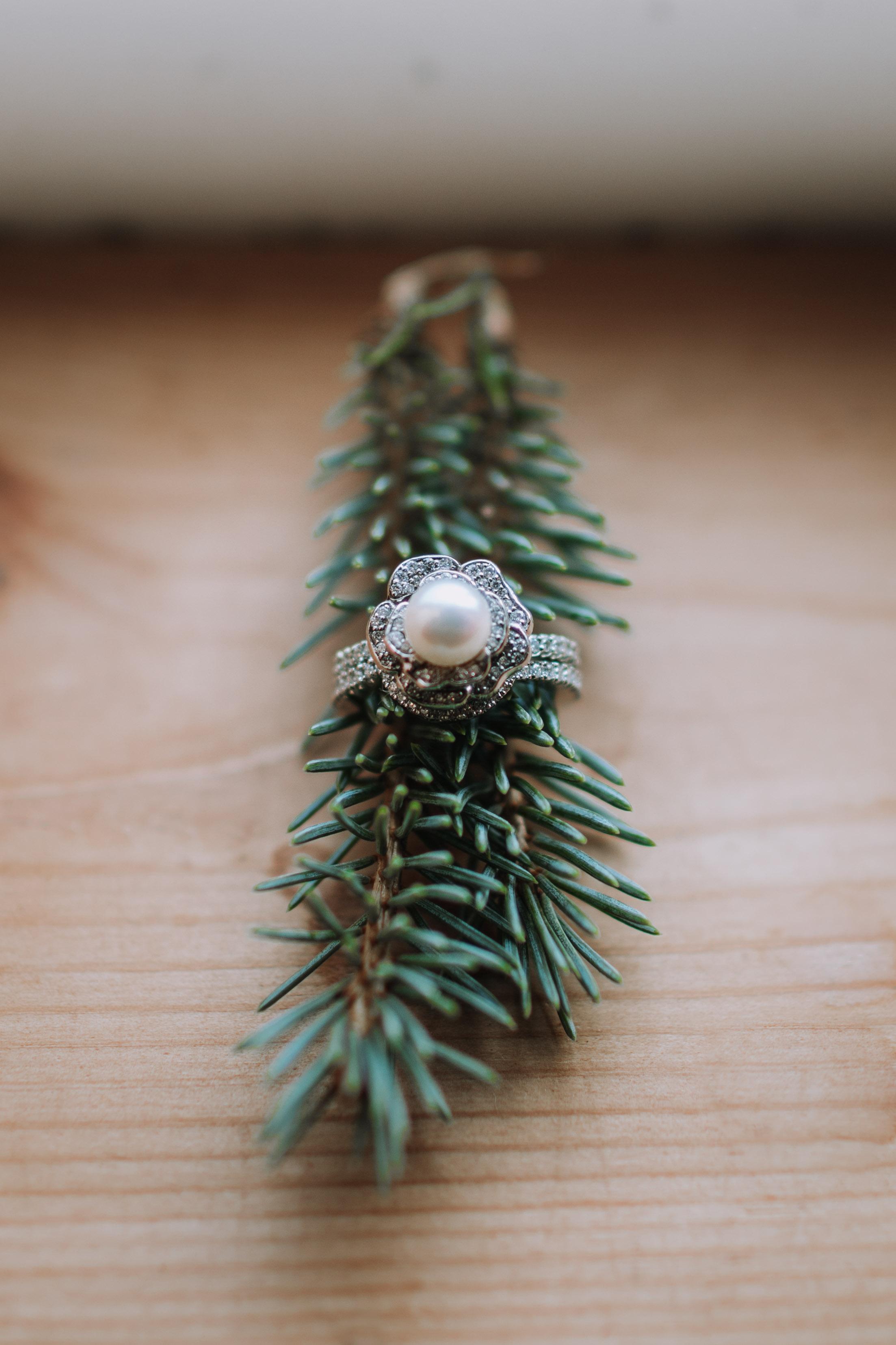 adam sophie red barn wedding arlington washington foggy day pnw pearl engagement ring