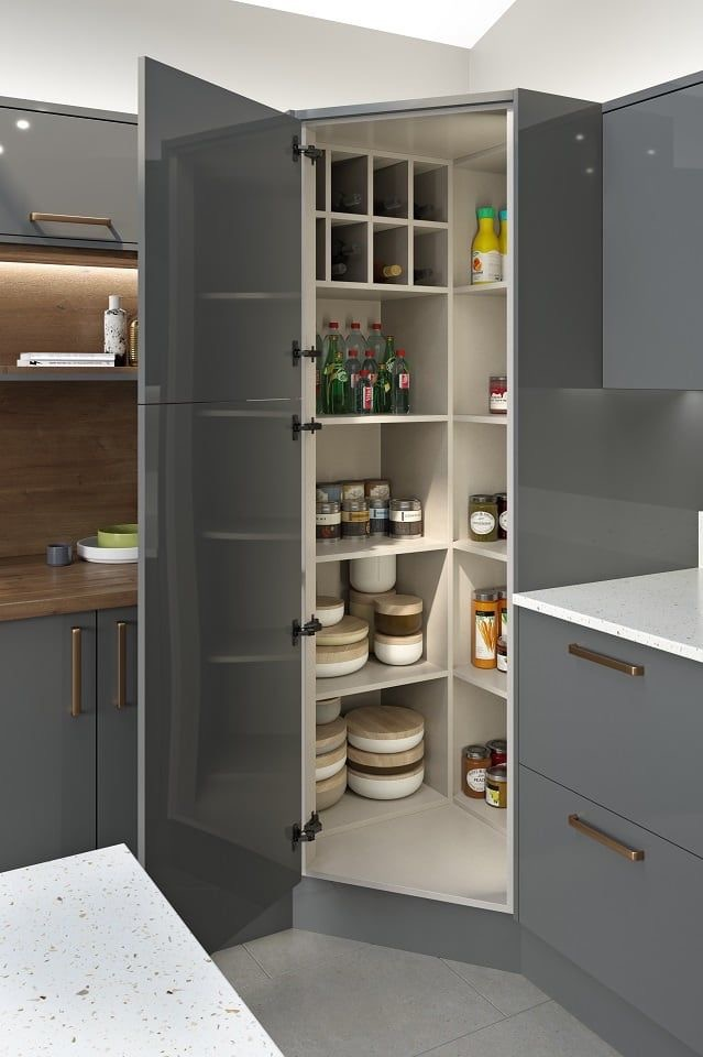 I love this idea of using the corner of a kitchen for a large pantry style cupboard. These corners are often difficult to make the best use of, and while this corner cupboard is large, it contains loads of storage and doesn't take up as much space as a walk in pantry would. (credit LochAnna Kitchens)