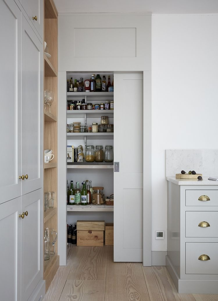 How gorgeous is this secret pantry behind a flush concealed door. source https://www.remodelista.com/posts/reader-rehab-a-photographers-kitchen-in-london/