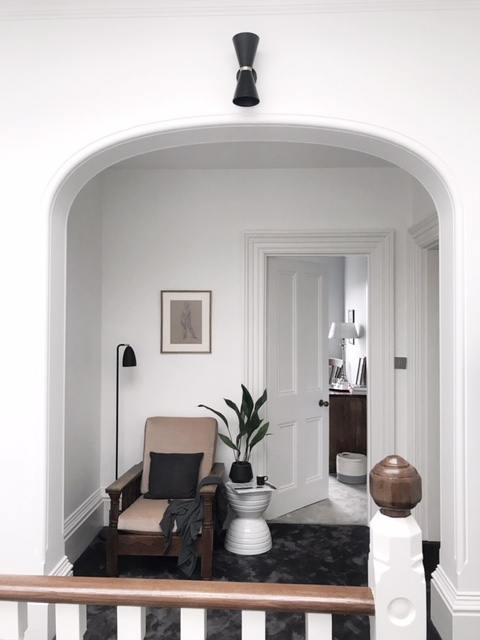 I love how Susannah has created this comfy nook on the landing with an upholstered Parker Knoll chair was passed on to her .
