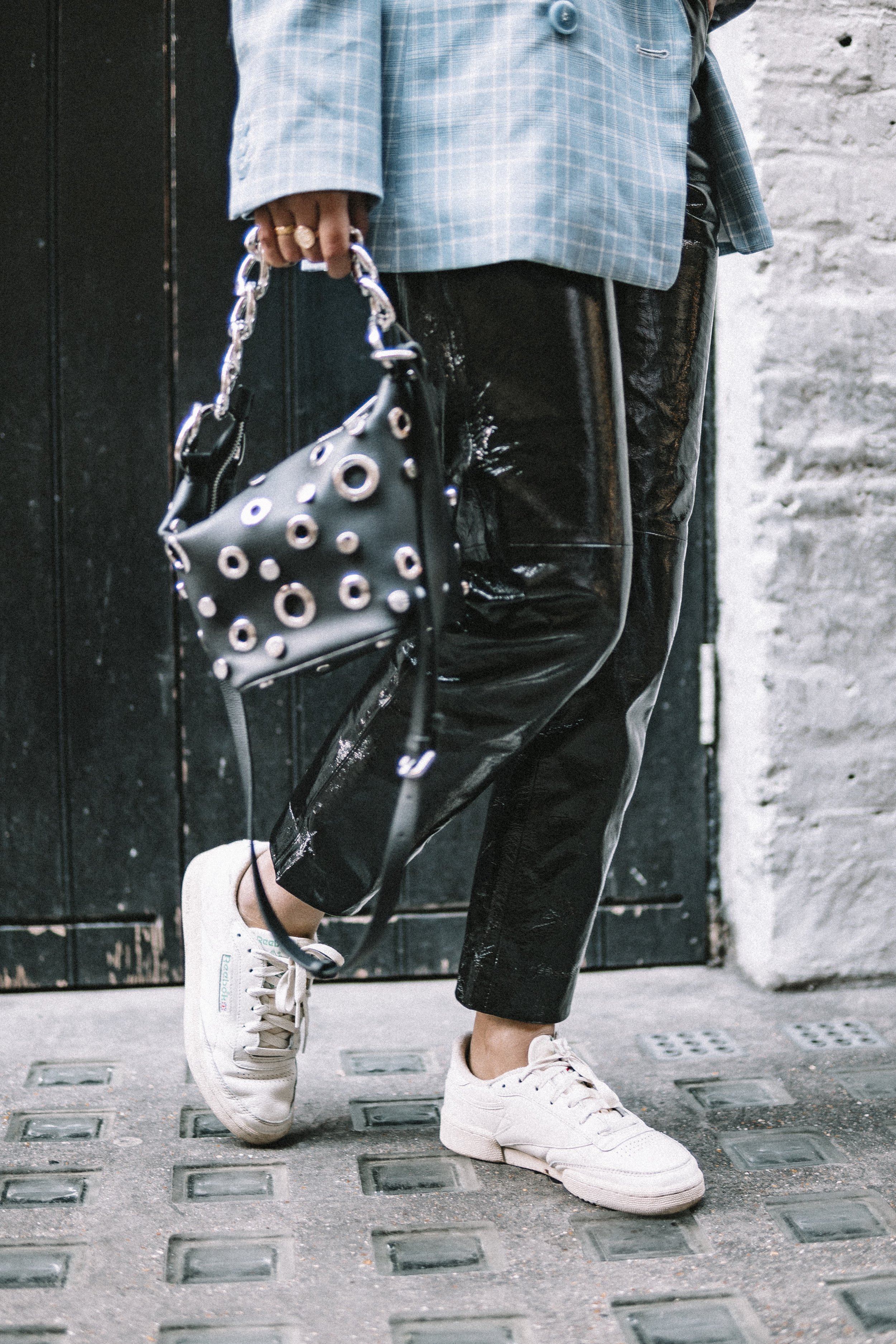 Keep it classic but vamp up with edginess with a slick pair of leather trousers and an over accessorised bag. The metals bounce off the leather fabric so well & creates such a fun vibe to the outfit. Ive kept it casual with the Reebok Classic Club C too! My go-to trainers of the moment. -