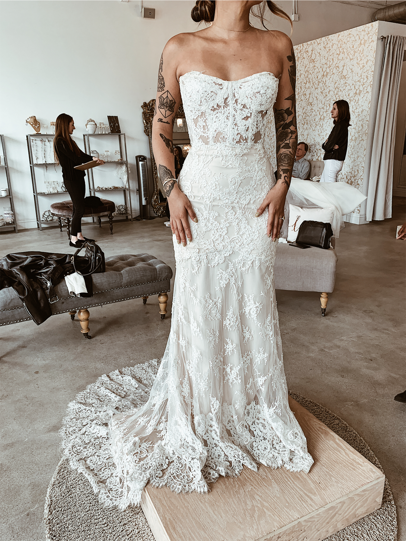 The classic romantic - This was such a beautiful dress. Simple, classic, chic and comfortable. I wasn't a huge fan of strapless as I felt like my small chest wouldn't look right but this fitted so well and complimented my frame. I love the see through corset detail and the beautiful lace train on this one!